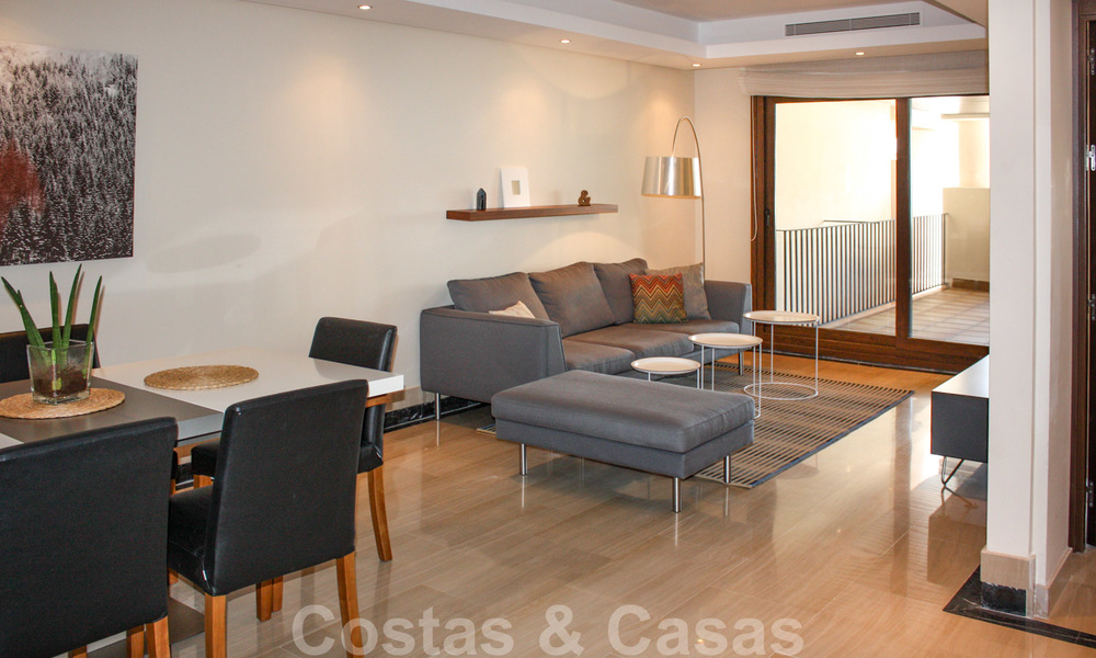 Modern apartment for sale in a frontline beach complex with sea views between Marbella and Estepona 25606