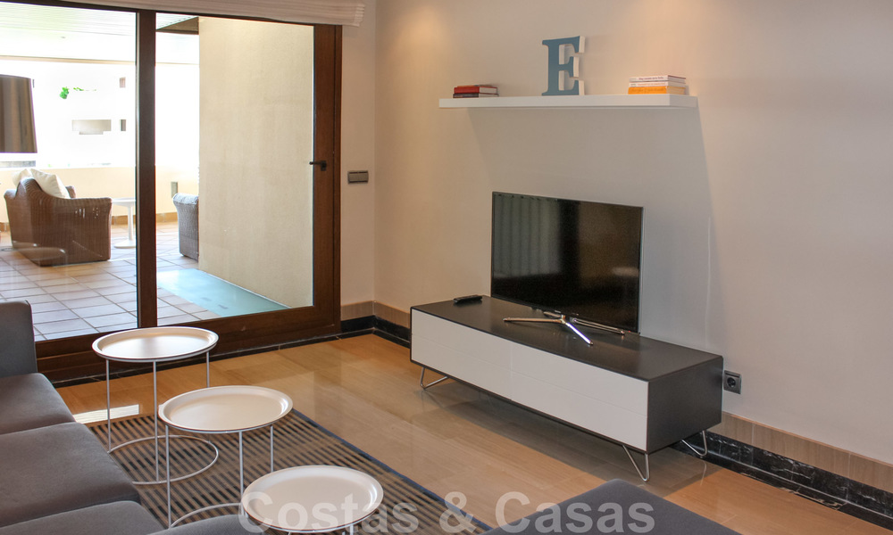 Modern apartment for sale in a frontline beach complex with sea views between Marbella and Estepona 25609