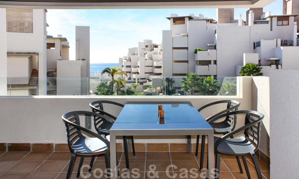 Modern apartment for sale in a frontline beach complex with sea views between Marbella and Estepona 25611