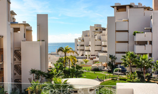 Modern apartment for sale in a frontline beach complex with sea views between Marbella and Estepona 25613