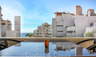 Modern apartment for sale in a frontline beach complex with sea views between Marbella and Estepona 25614