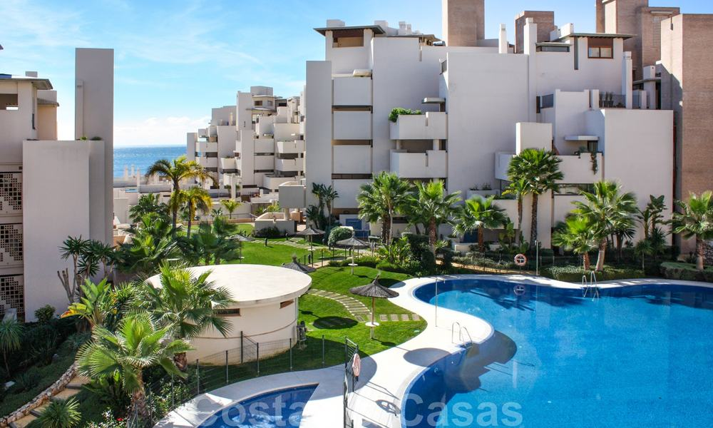 Modern apartment for sale in a frontline beach complex with sea views between Marbella and Estepona 25615