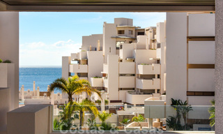 Modern apartment for sale in a frontline beach complex with sea views between Marbella and Estepona 25616