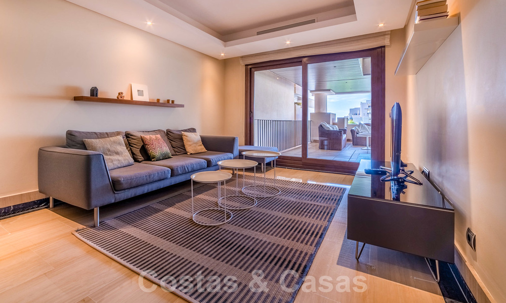 Modern apartment for sale in a frontline beach complex with sea views between Marbella and Estepona 25629