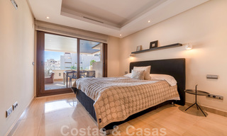Modern apartment for sale in a frontline beach complex with sea views between Marbella and Estepona 25631