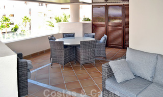 Modern apartment for sale in a first line beach complex with sea view, between Marbella and Estepona 25724