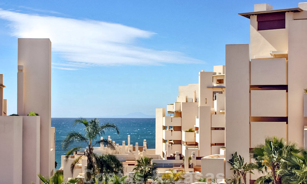 Modern apartment for sale in a first line beach complex with sea view, between Marbella and Estepona 25728