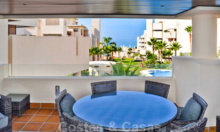 Modern apartment for sale in a first line beach complex with sea view, between Marbella and Estepona 25735