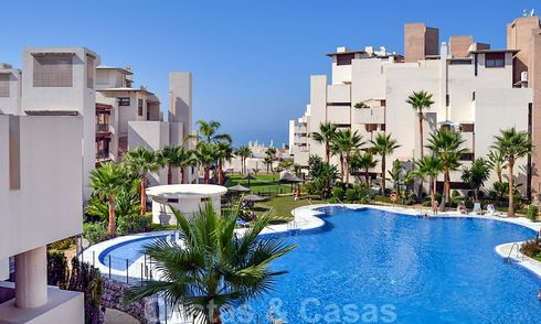 Modern apartment for sale in a first line beach complex with sea view, between Marbella and Estepona 25736