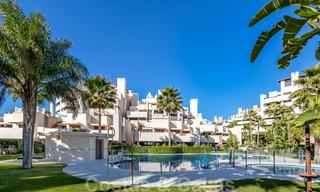 Modern apartment for sale in a first line beach complex with sea view, between Marbella and Estepona 25742