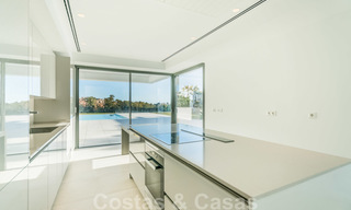 Ready to move in new modern luxury villa for sale, located directly on the golf course in Marbella - Benahavis 25860