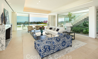First line golf villa in elegant modern style with panoramic golf and sea views for sale in Los Flamingos Golf in Marbella - Benahavis 26113