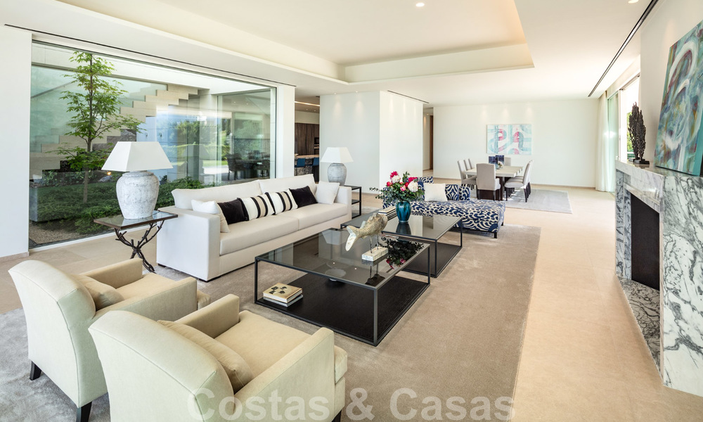 First line golf villa in elegant modern style with panoramic golf and sea views for sale in Los Flamingos Golf in Marbella - Benahavis 26114