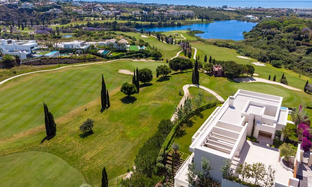 First line golf villa in elegant modern style with panoramic golf and sea views for sale in Los Flamingos Golf in Marbella - Benahavis 26121