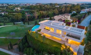 First line golf villa in elegant modern style with panoramic golf and sea views for sale in Los Flamingos Golf in Marbella - Benahavis 26124