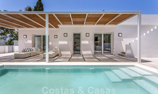 First line golf and a stone's throw from the beach located designer villa for sale in the chic Guadalmina Baja in Marbella 26315