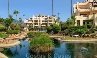 Luxury apartment for sale with open garden and sea views in a first line beach complex, on the New Golden Mile between Marbella and Estepona 26844