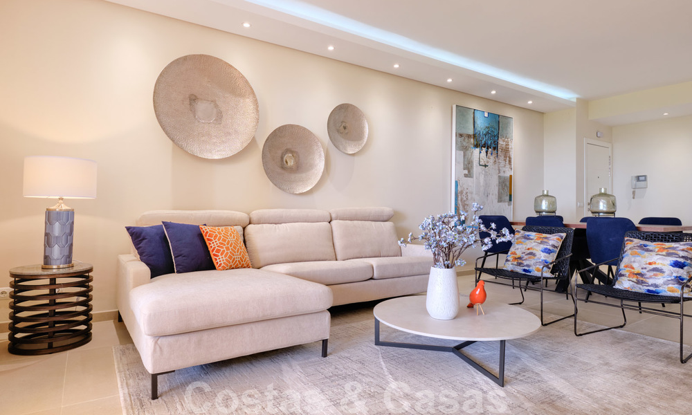 Luxury apartment for sale with open garden and sea views in a first line beach complex, on the New Golden Mile between Marbella and Estepona 26853