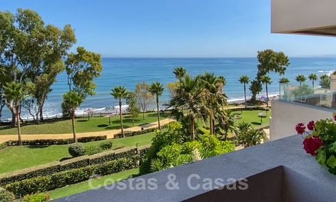 Modern apartment for sale on the first row of a beachfront complex with open sea views located between Marbella and Estepona 27000