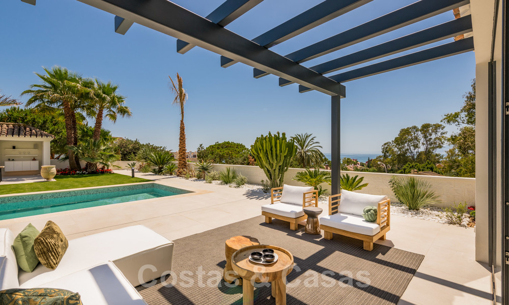 Ready to move in contemporary Mediterranean villa with sea views for sale at a short walking distance to the beach and all amenities, beach side Elviria in Marbella 27546