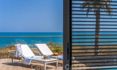 Ready to move in modern luxury front line beach villa for sale in an exclusive complex in Estepona, Costa del Sol 28219