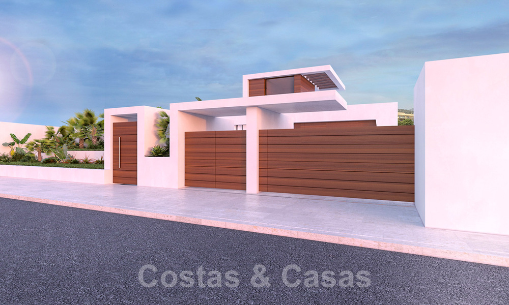Modern new build villa for sale, directly on the golf course with panoramic golf, mountain and sea views in Estepona 30875