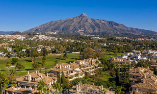 Spacious luxury penthouse with panoramic views for sale on a golf course in Nueva Andalucia, Marbella 32092